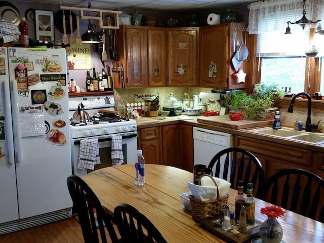 Kitchen well-stocked w/food, gas range & Keurig coffee bar.