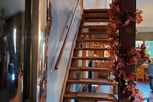 Staircase up to loft. Staircase when built was sized for smaller feet. My 9s hang over. I go up sideways on a slant :)