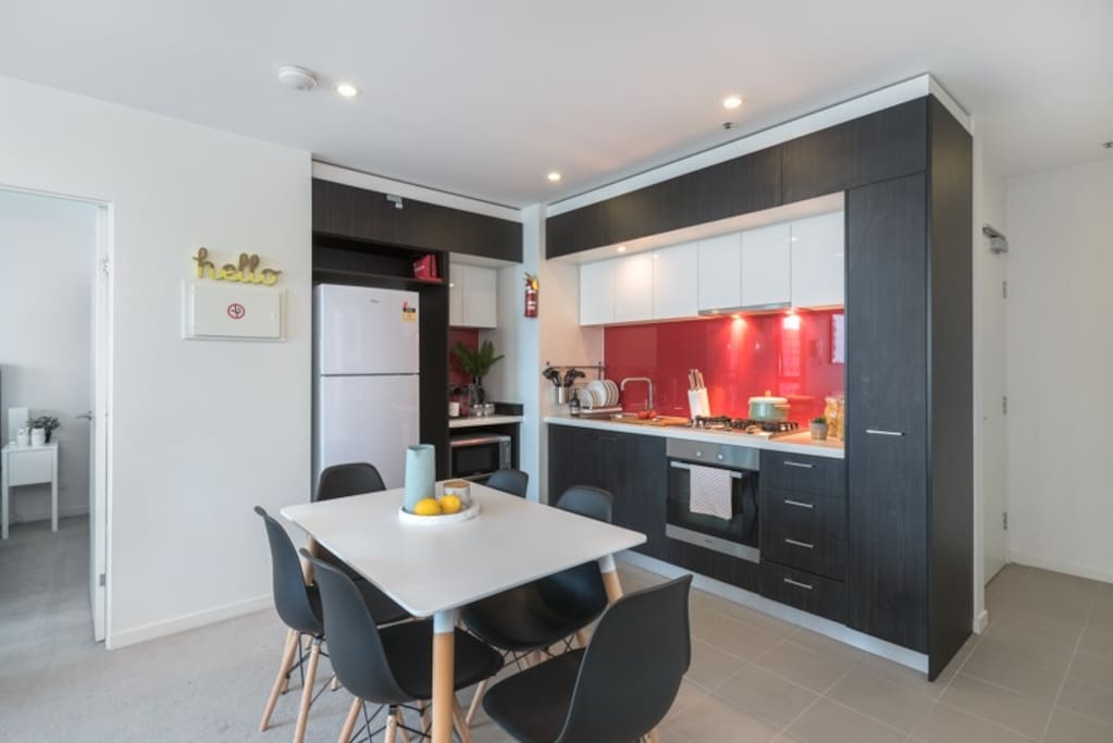 Whip up a delicious meal in this open kitchen that comes with cutlery and crockery for your convenience.