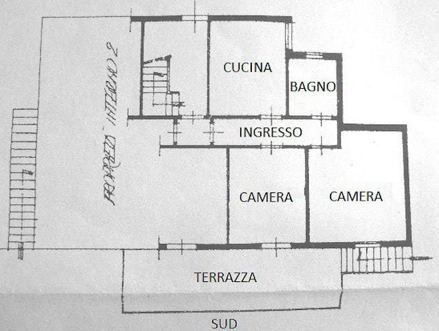 floor plan: kitchen and bathroom are separated from the two bedrooms by a corridor. The terrace is South-facing
