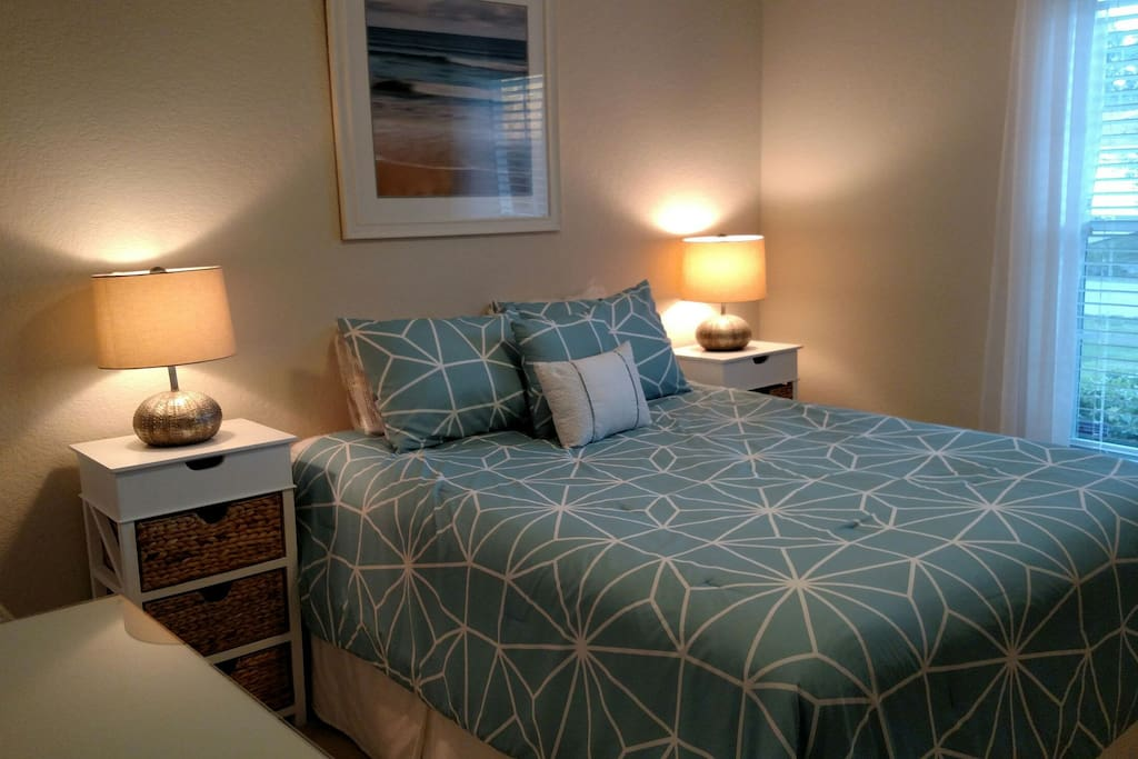Comfy queen bed with high quality mattress and linens.