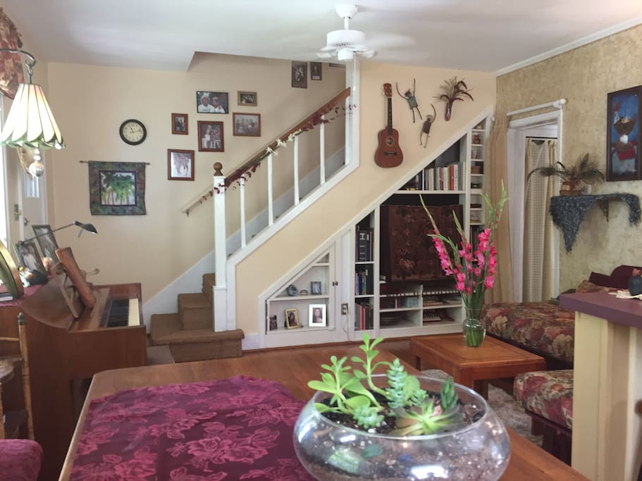 Seated at Dining room table looking into Living room and stairs