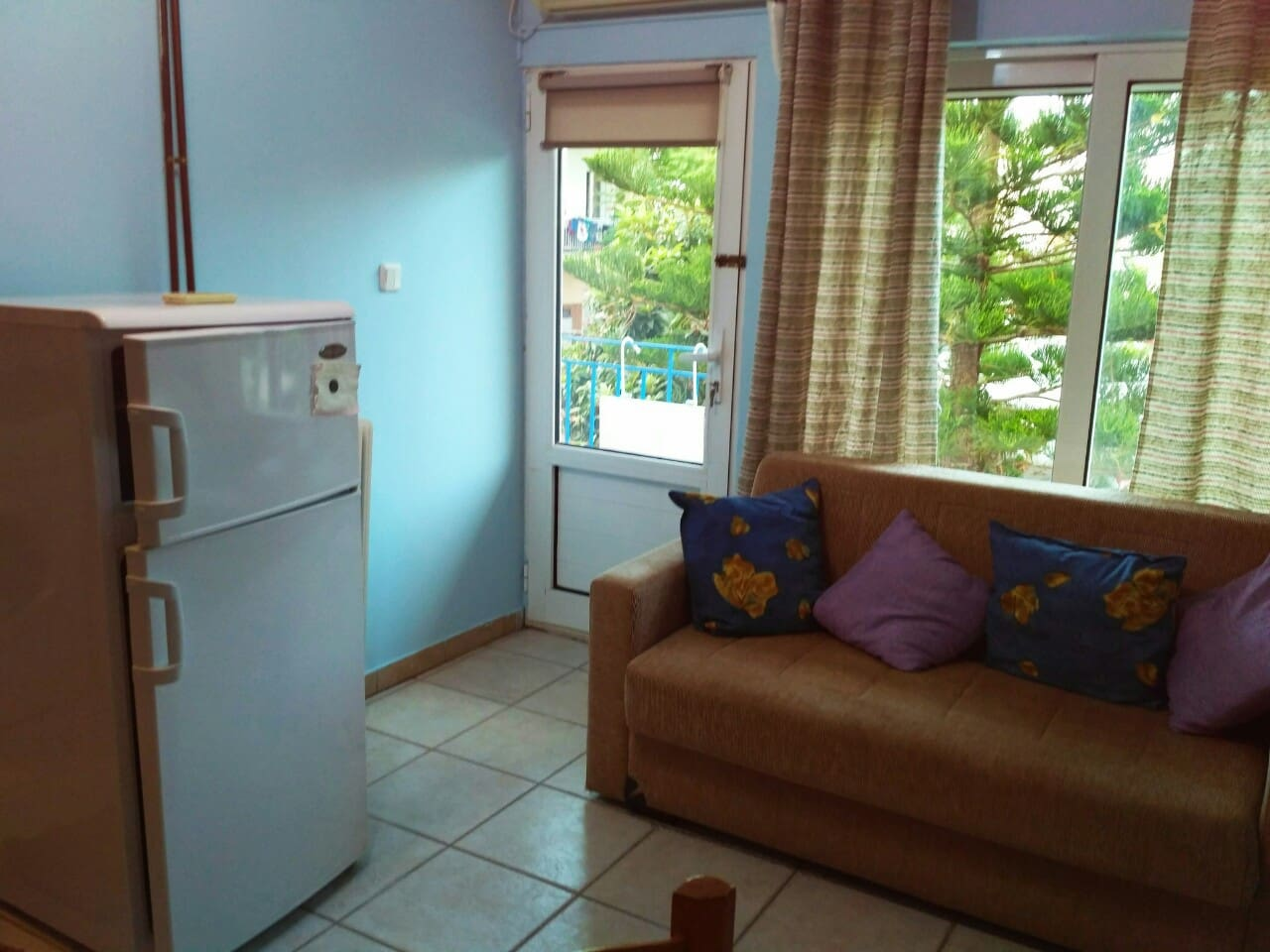 kitchen area with a sofa