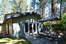 Nestled beneath the towering Jeffery pines, enjoy the fresh mountain air in your private yard.