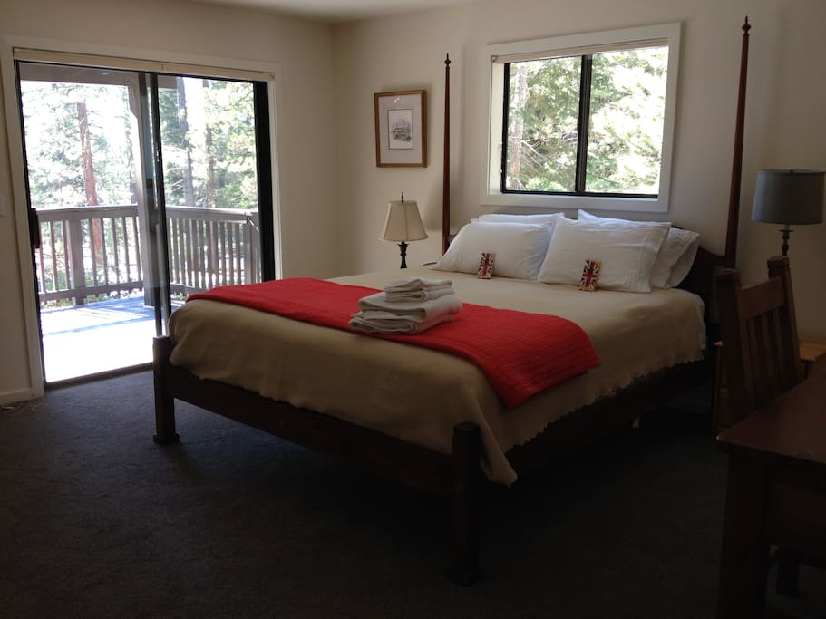 King bedded room with deck on lower level.