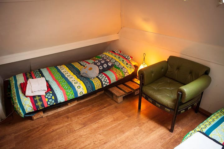 Dorm bed in a cozy farm house