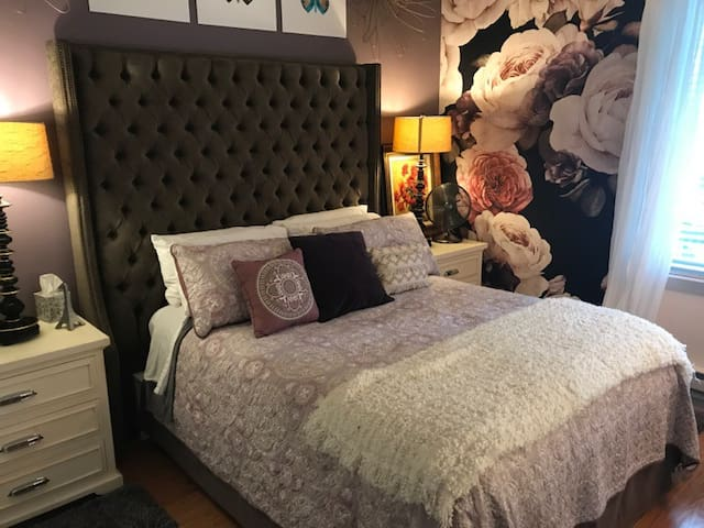 comfy but firm queen size mattress down and feather pillows  and we have no allergenic pillows available as well