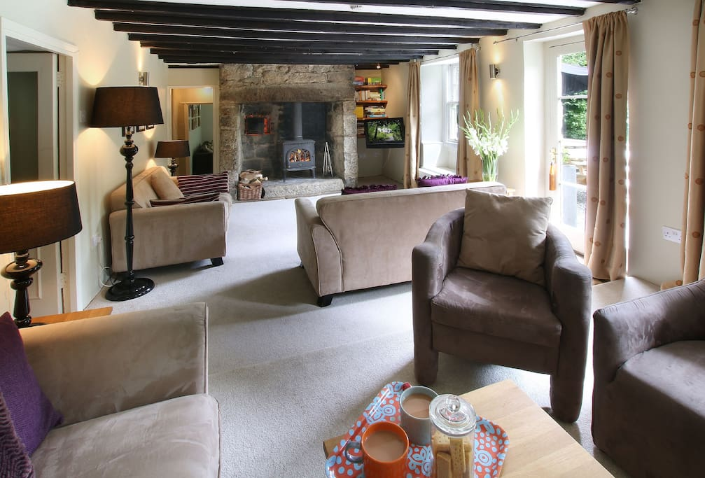 Ground floor: Sitting room with granite inglenook fireplace and wood burning stove