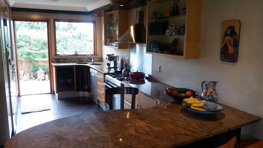Open- plan kitchen, fully equipped including dishwasher & washing machine