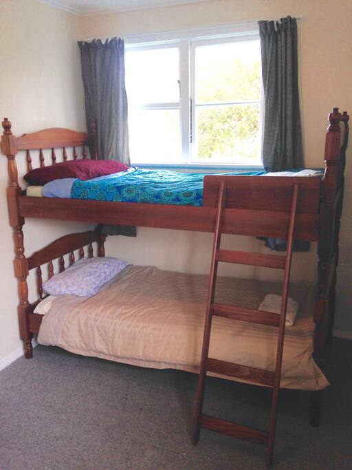 Guest room number two with Victorian style wooden bunks