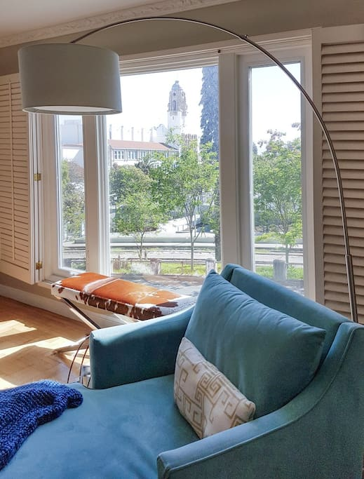 Relax with a view of the park out the window (Summer).