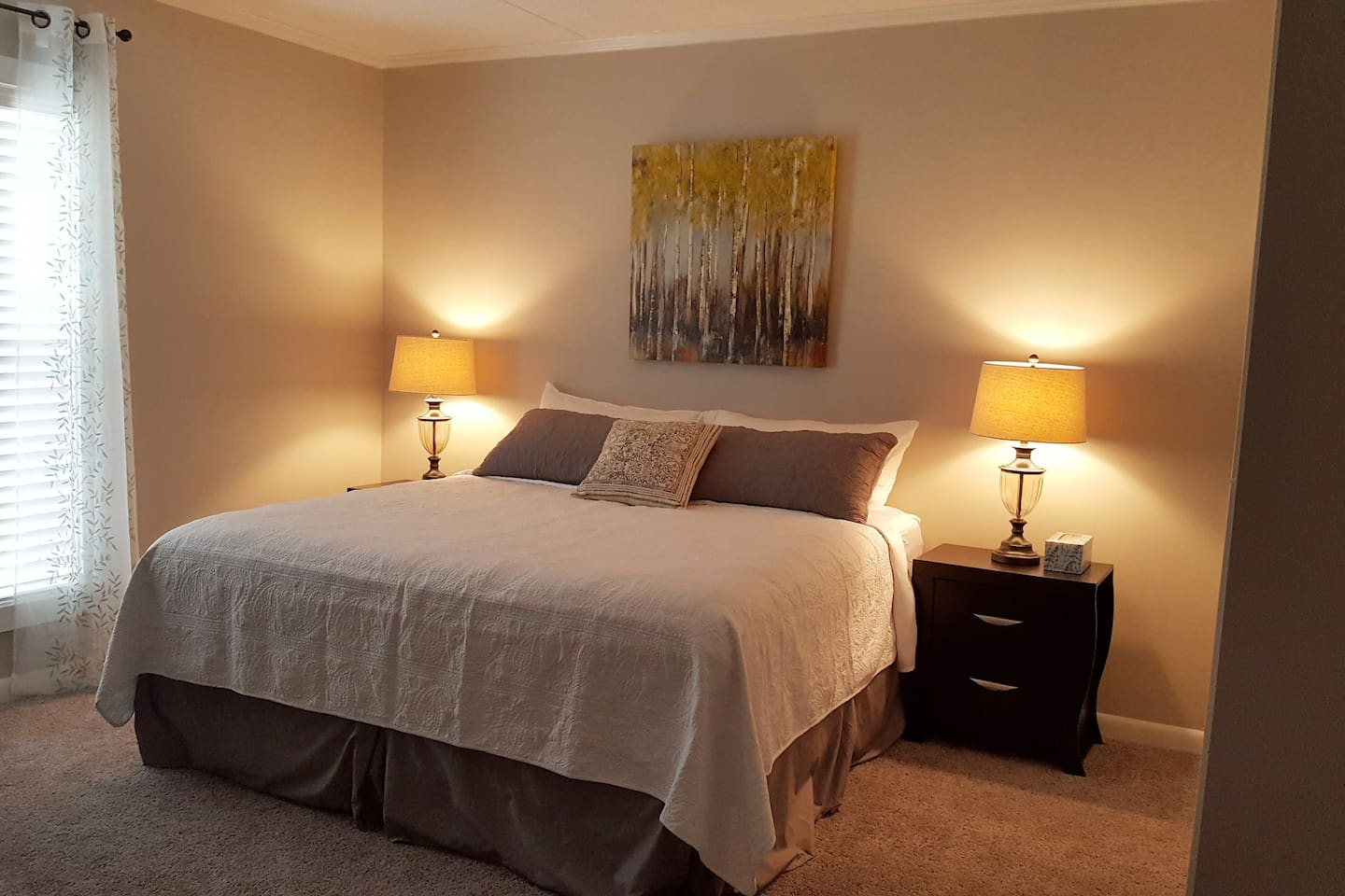 Comfortable king-size bed in bedroom