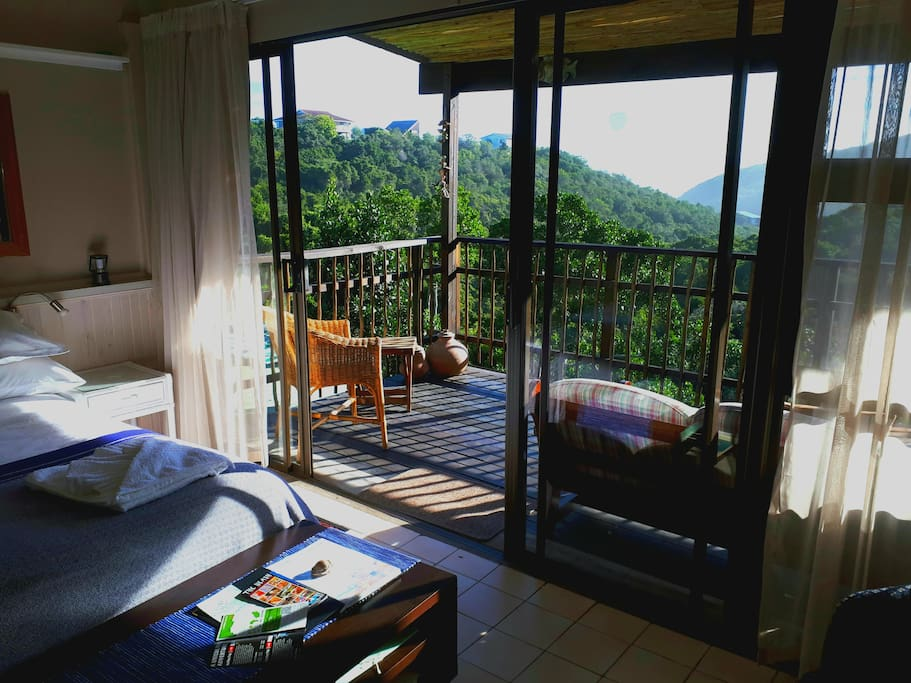 Main bedroom with scenic views from balcony.