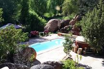 Take in spectacular canyon views in all directions from the seasonal swimming pool and hot tub. The half acre seasonal pond and island are is amidst the jungly greenery directly below.