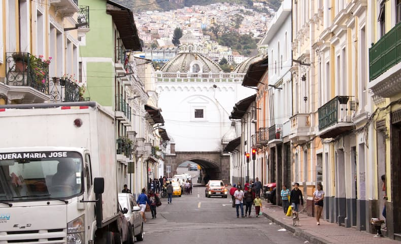 The historical parish of La Loma Grande, from 1734, with Santo Domingo´s arc on its start. Experience Quito like a local. The block is busy. However, it does not have downtown´s heavy traffic.