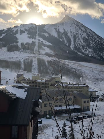Morning sunrise over the butte! Patio view overlooking ski area. Experience Mountain Zen with views from every room and bedroom! Enjoy your morning coffee sitting outside on patio .