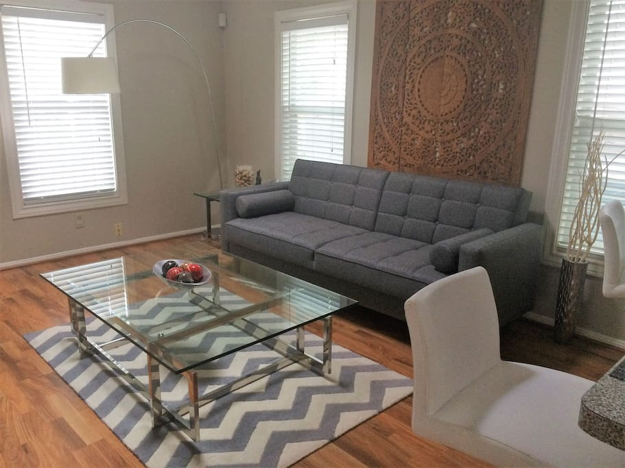 Large midcentury sofa which converts to a bed