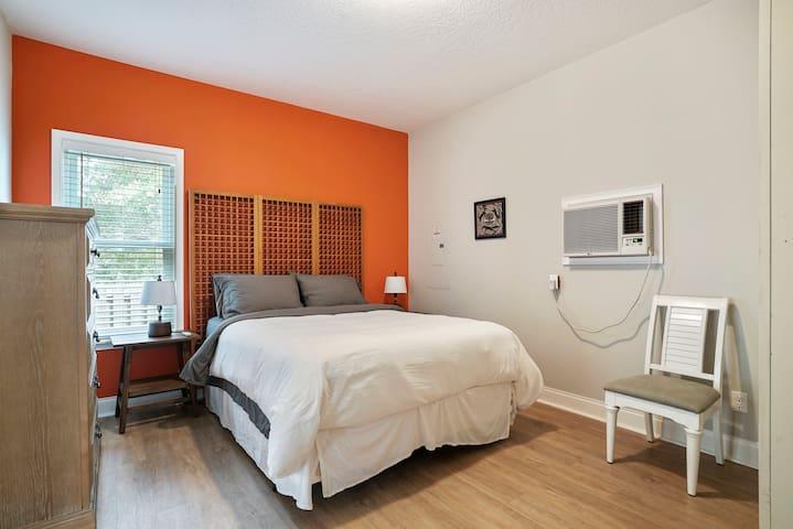 Bedroom with queen bed and plenty of storage