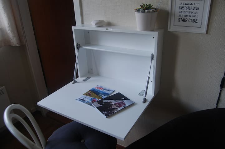 A foldable wall table were you can use your laptop or write a letter.