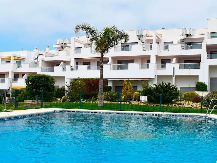 Ground floor apartment with private garden and terrace, communal pool, sleeps 4.