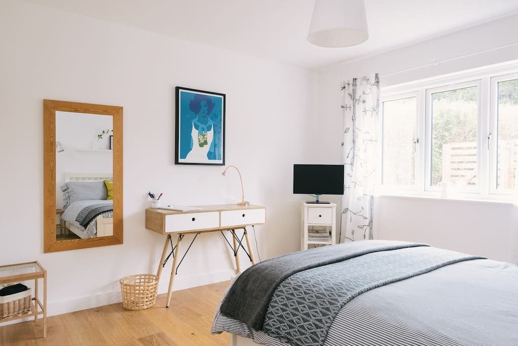 Underfloor heating means the room is always lovely and warm.  Desk, Smart TV and full-length mirror