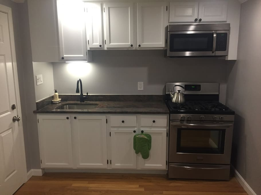New Stainless Steel appliances. Kitchen is fully stocked with plates, glasses, utensils, etc