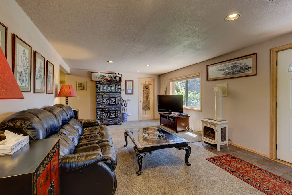 The living area features a gas stove, flat screen TV and a queen-sized sleeper sofa.