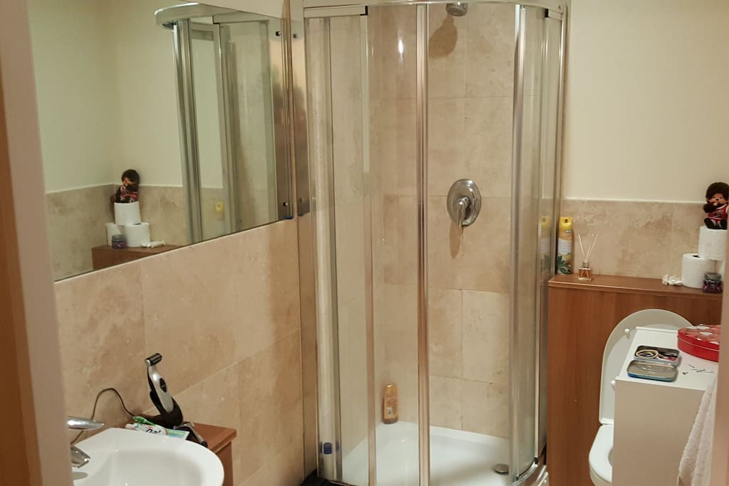 The private bathroom with a large shower