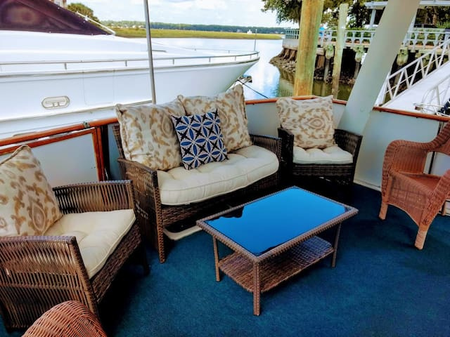 Enjoy beautiful sunsets from the covered aft deck.