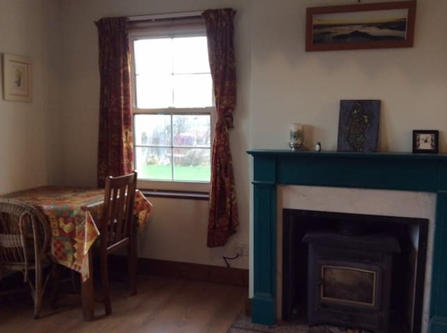 Sitting/ Dining Area with solid fuel stove