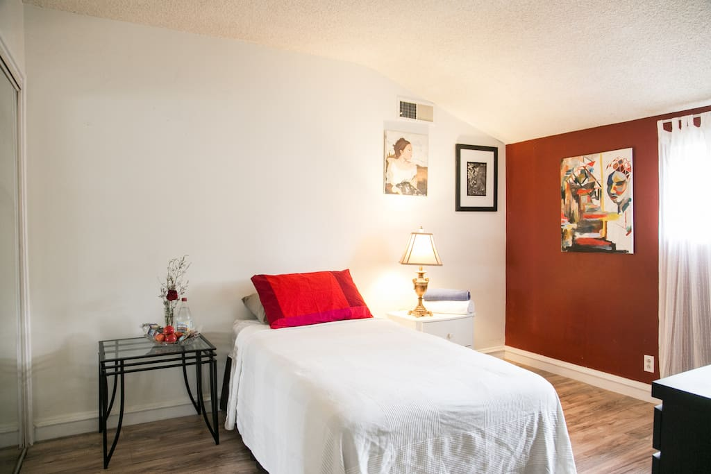 Your room with fresh sheets, towels, desk & guest welcome snack basket