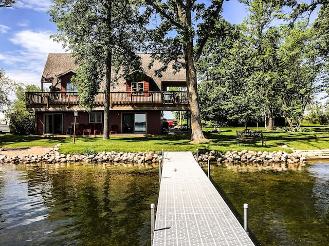 Executive Home on Penninsula of North Long Lake.