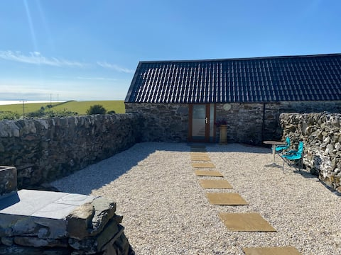 The Bothy is a rural, coastal, studio cottage.