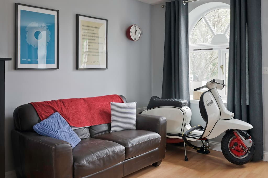 Sofa and old scooter.