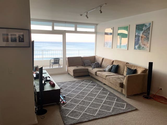 "Living room with a large comfortable sofa, 60"" inch Smart Tv with Netflix, as well as PlayStation 4"