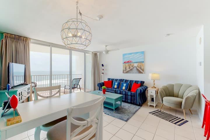 Colorful 12th floor condo with Gulf views, shared hot tub and pool, and balcony!