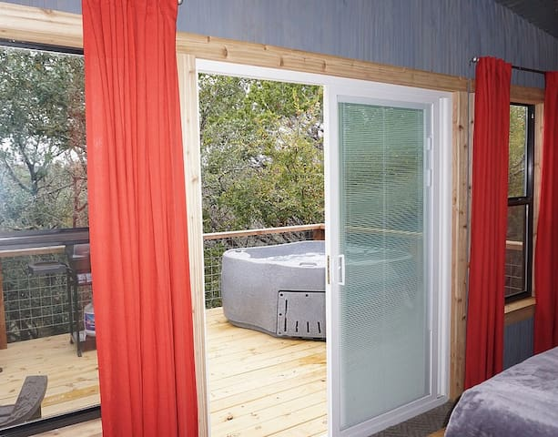 The sliding doors open from the bedroom to the deck