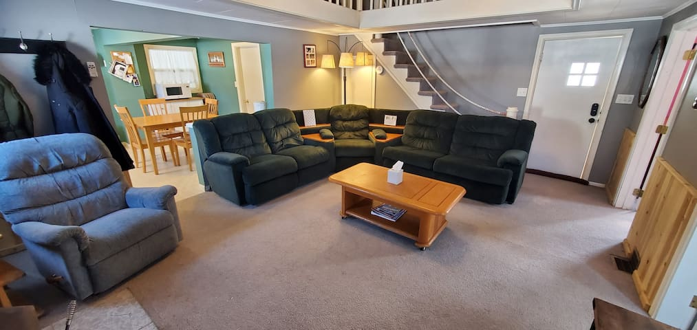 Family room sectional with 2 built in recliners and a queen pullout bed.