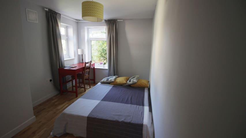 A garden view,  en suite room and  comfort sleep