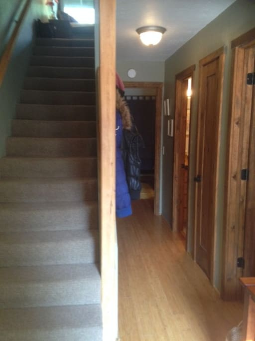 Front Entry way (the doors lead to the 2 bedrooms + downstairs bath)