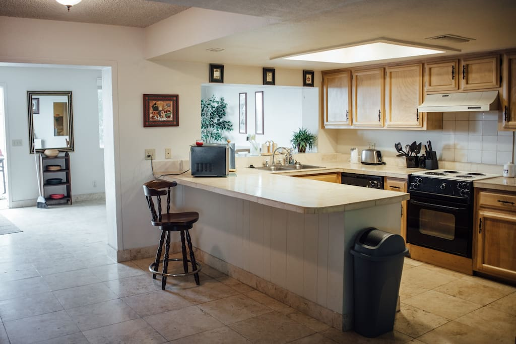 Huge kitchen with bar counter.