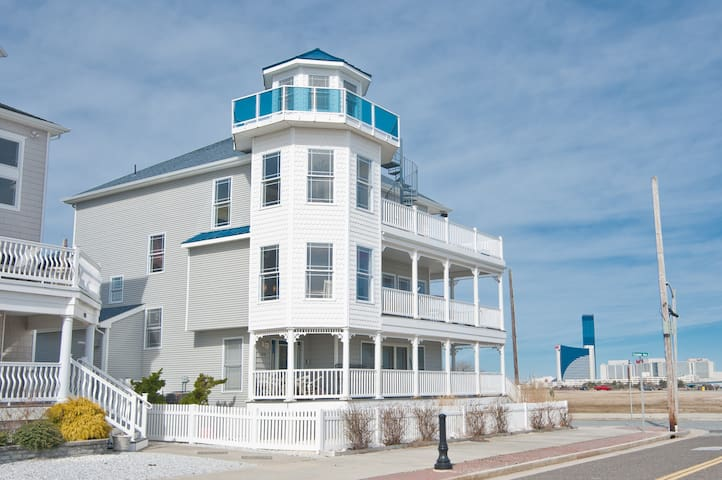 """❤️ Welcome to your custom built """"Corner Beach House"""" for the GUARANTEED BEST Ocean and Inlet views available in Atlantic City.  From any one of five decks watch a sunrise and a sunset, see the casinos light up for the evening, feel the ocean breezes, see the full moon rise over the ocean casting moonbeams that seem to come right to you, watch your family and friends on the protected beach just steps from your front door! Enjoy a BBQ on the deck! Yes!"""