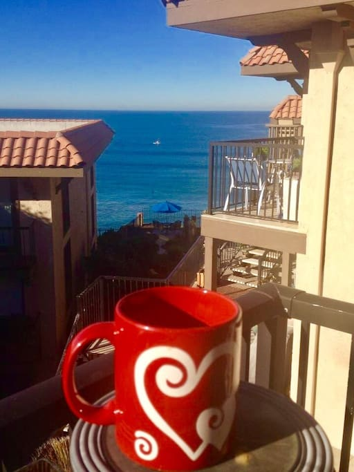 Enjoy the beautiful ocean view while drinking a cup of coffee from the balcony off the living room