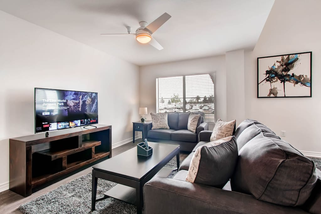 "Sit back and relax in the chic living room with 55"" HDTV featuring free Netflix and WIFI"