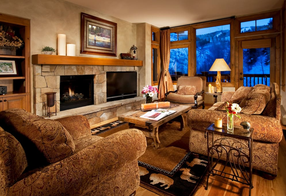 Relax in the luxurious living area, complete with fireplace