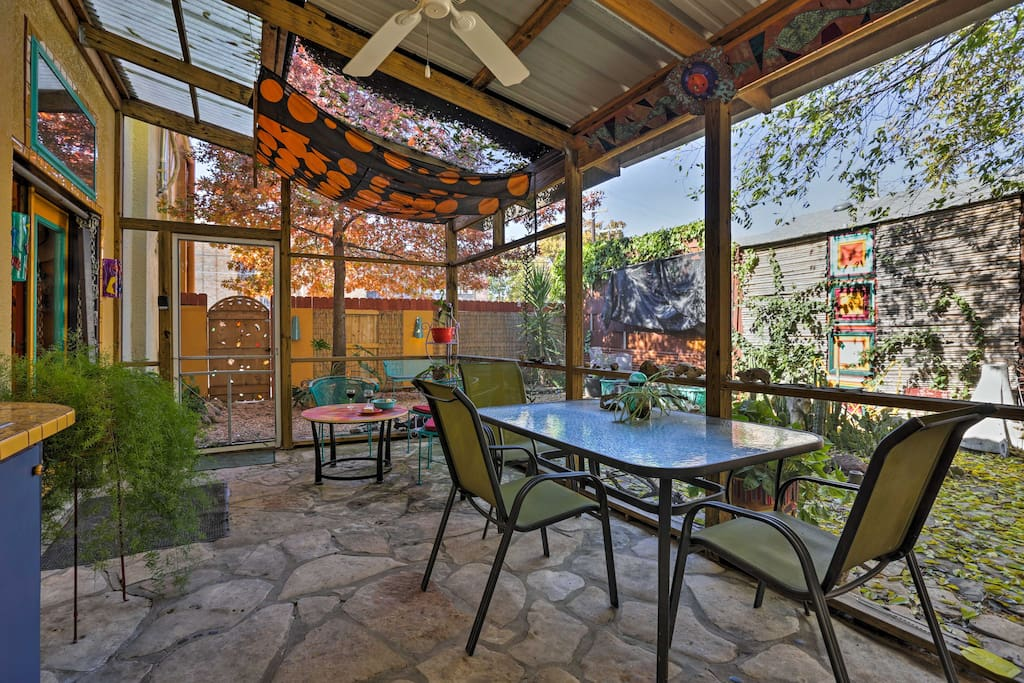 Relax outdoors on the screened-in patio no matter the weather.