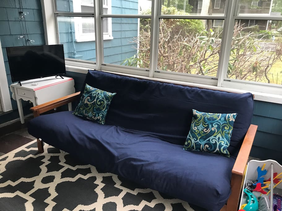 Three season room. This futon can sleep an addition person and isn't included in the bed count.