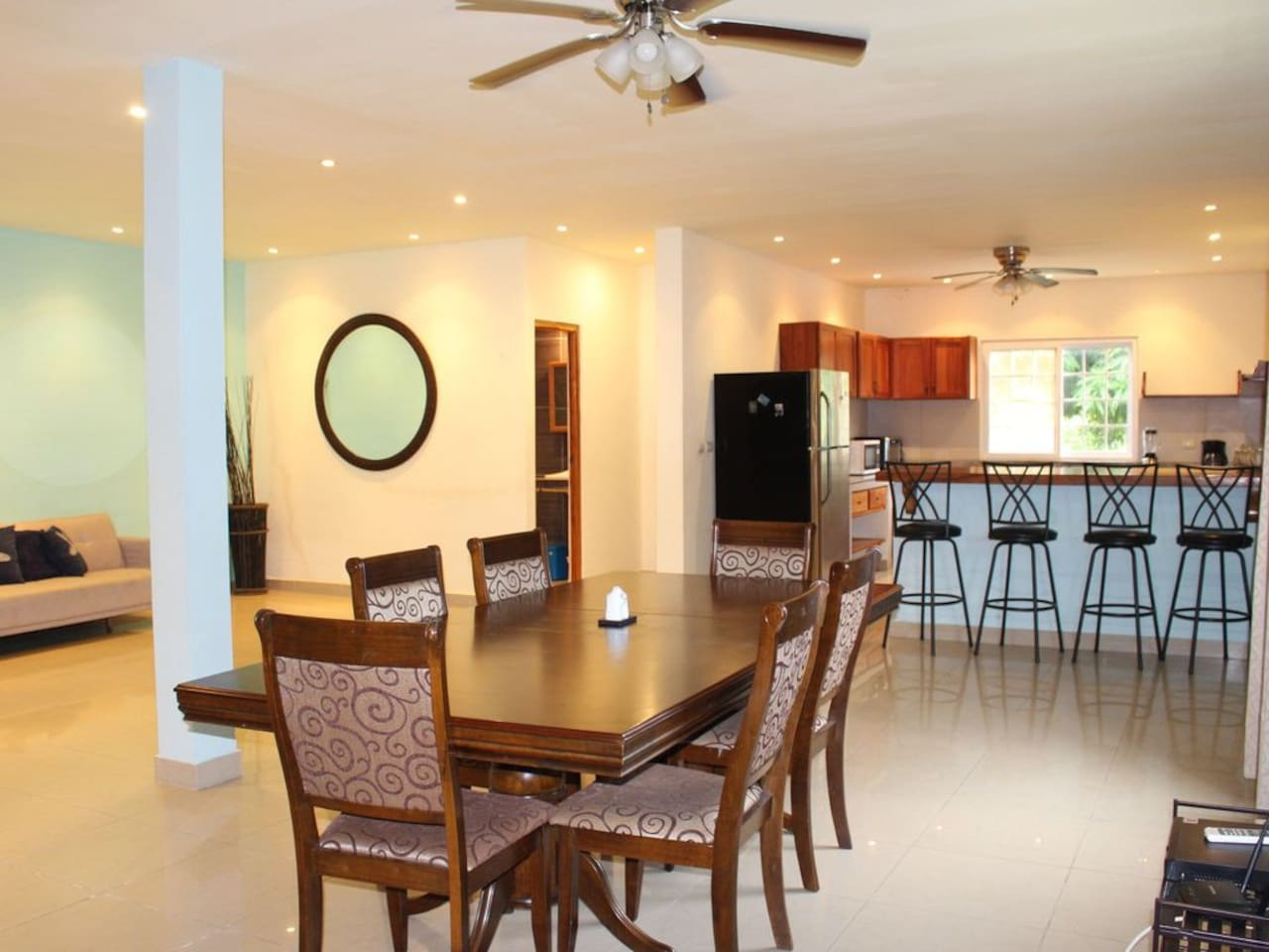 Great room featuring dining table for 6 and bar seating for 4.