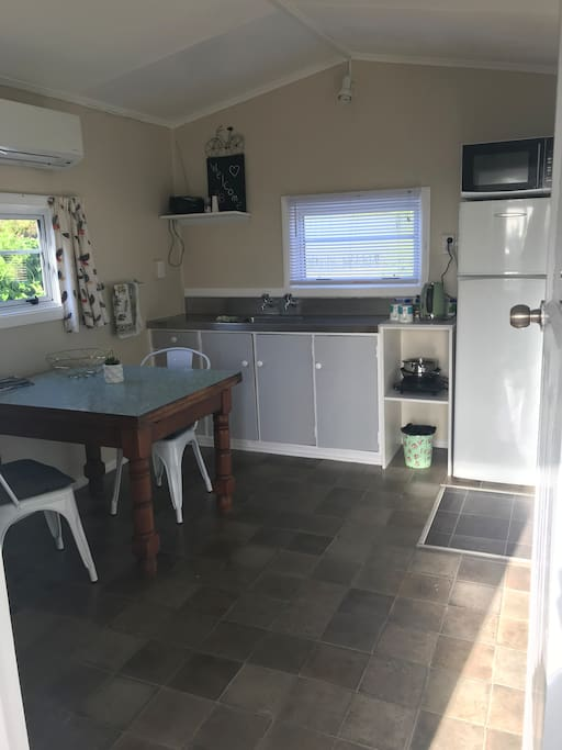 Own kitchen with fridge, freezer, table and chairs, books, magazines, games, microwave, electric fry pan, convection element and all utensils, crockery etc.