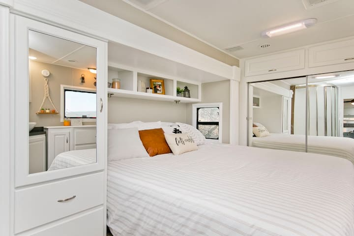 Master Bedroom with King size bed, and locking pocket door for privacy